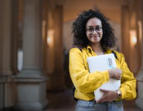 girl holding an intern group laptop