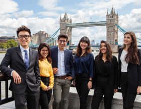 interns in front of london bridge