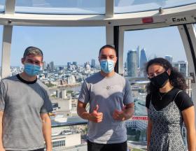 Interns on the London eye wearing face masks