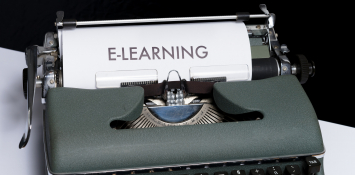 """A white page in a typewriter says """"E-learning"""""""