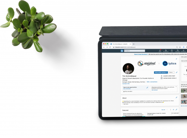 A computer tablet shows a LinkedIn profile