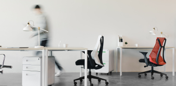 An empty office with desks and chairs