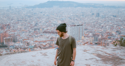 A man stands on a rooftop in Barcelona