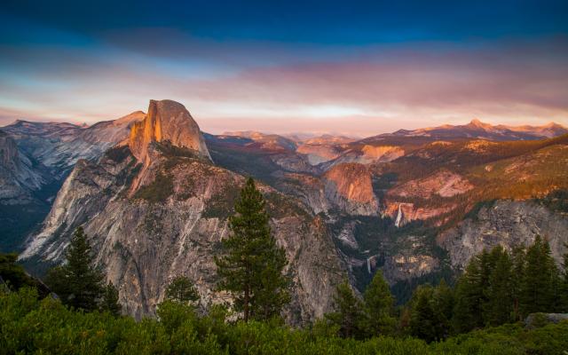 Yosemite's famous stone cliffs at sunset.